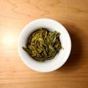 A top-side view of a Long Jin tea in a Gaiwan