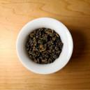 A top-side view of a Jing Shuan tea in a Gaiwan